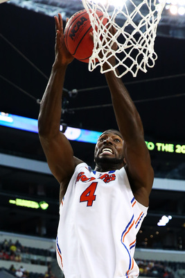 ARLINGTON, TX - MARCH 31:  Patric Young #4 of the Florida Gators goes up against the Michigan Wolverines in the second half during the South Regional Round Final of the 2013 NCAA Men's Basketball Tournament at Dallas Cowboys Stadium on March 31, 2013 in A