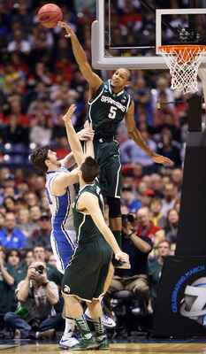 INDIANAPOLIS, IN - MARCH 29:  Adreian Payne #5 of the Michigan State Spartans blocks a shot attempt by Ryan Kelly #34 of the Duke Blue Devils during the Midwest Region Semifinal round of the 2013 NCAA Men's Basketball Tournament at Lucas Oil Stadium on Ma