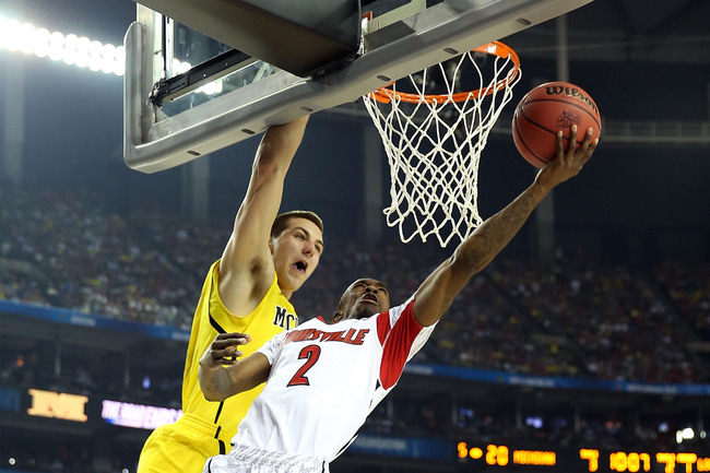 ATLANTA, GA - APRIL 08:  Russ Smith #2 of the Louisville Cardinals drives for a shot attempt in the first half against Mitch McGary #4 of the Michigan Wolverines during the 2013 NCAA Men's Final Four Championship at the Georgia Dome on April 8, 2013 in At