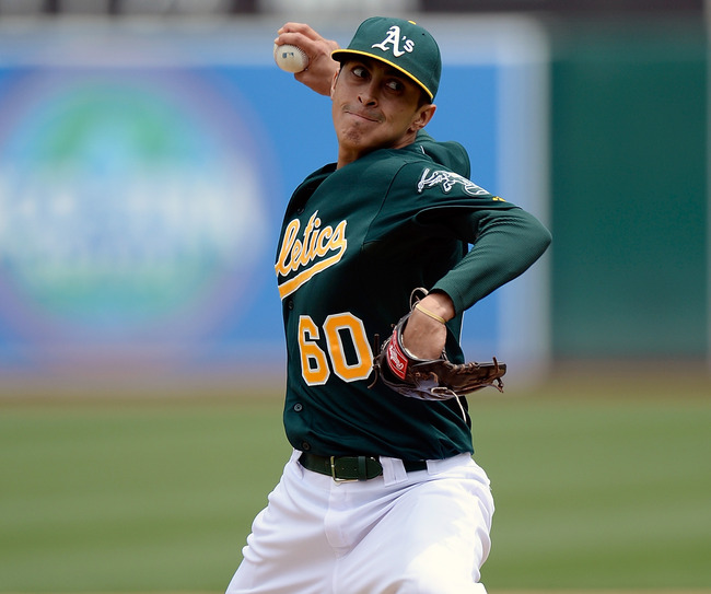 OAKLAND, CA - MAY 15:  Jesse Chavez #60 of the Oakland Athletics pitches against the Texas Rangers in the fifth inning at O.co Coliseum on May 15, 2013 in Oakland, California.  (Photo by Thearon W. Henderson/Getty Images)