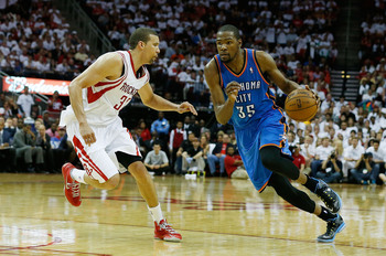HOUSTON, TX - APRIL 27:  Kevin Durant #35 of the Oklahoma City Thunder drives against Francisco Garcia #32 of the Houston Rockets in Game Three of the Western Conference Quarterfinals of the 2013 NBA Playoffs at the Toyota Center on April 27, 2013 in Hous