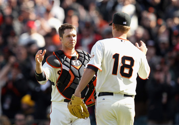 Buster Posey congratulates Matt Cain after a stellar outing.