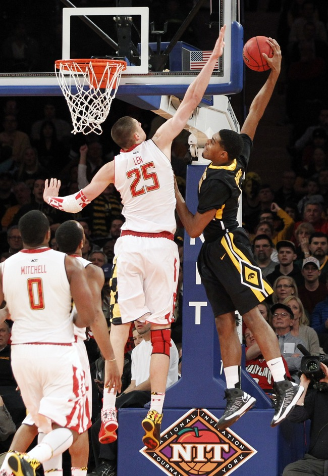 NEW YORK, NY - APRIL  02: Anthony Clemmens #5 of the Iowa Hawkeyes dunks over a defending Alex Len #25 of the Maryland Terapins in the first half during the 2013 NIT Championship - Semifinals at the Madison Square Garden on April 2, 2013 in New York City.