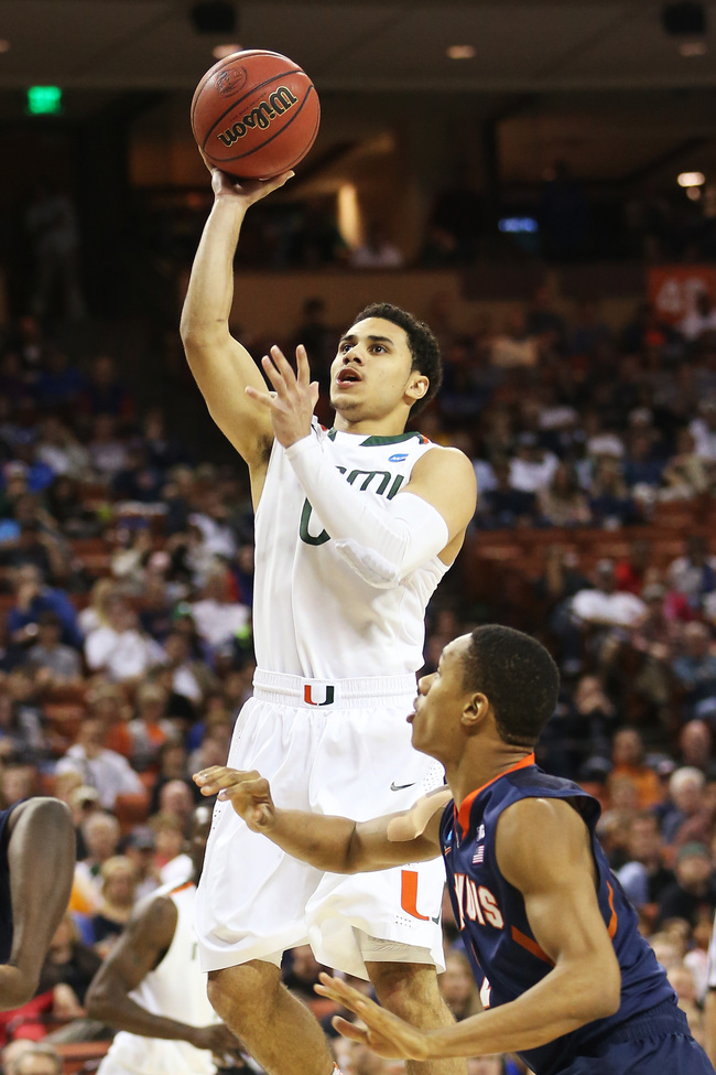 AUSTIN, TX - MARCH 24:  Shane Larkin #0 of the Miami Hurricanes shoots over D.J. Richardson #1 of the Illinois Fighting Illini in the second half during the third round of the 2013 NCAA Men's Basketball Tournament at The Frank Erwin Center on March 24, 20