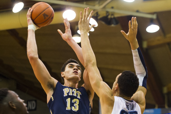 Jan 16, 2013; Villanova, PA, USA; Pittsburgh Panthers center Steven Adams (13) shoots under pressure from Villanova Wildcats forward Maurice Sutton (25) during the second half at the Pavilion. Pitt defeated Villanova 58-43. Mandatory Credit: Howard Smith-