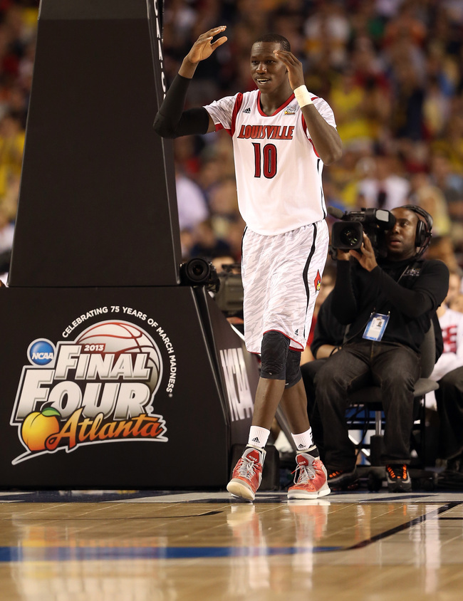 ATLANTA, GA - APRIL 08:  Gorgui Dieng #10 of the Louisville Cardinals reacts against the Michigan Wolverines during the 2013 NCAA Men's Final Four Championship at the Georgia Dome on April 8, 2013 in Atlanta, Georgia.  (Photo by Andy Lyons/Getty Images)