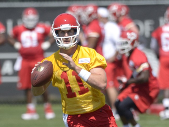 May 15, 2013; Kansas City, MO, USA; Kansas City Chiefs quarterback Alex Smith (11) throws a pass during organized team activities at the University of Kansas Hospital Training Complex. Mandatory Credit: Denny Medley-USA TODAY Sports