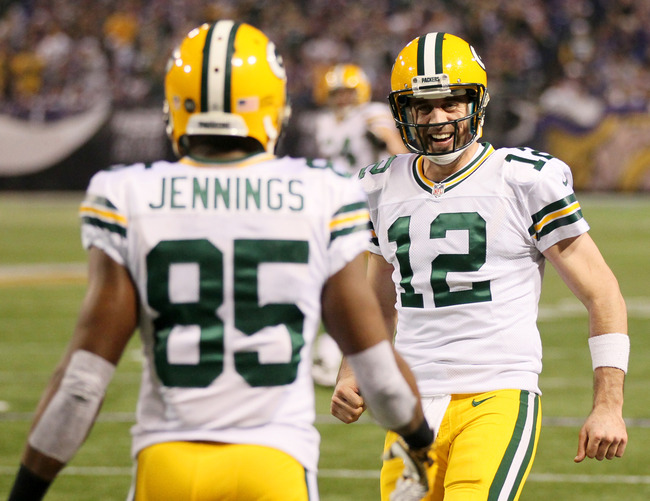 MINNEAPOLIS, MN - DECEMBER 30: Greg Jennings #85 of the Green Bay Packers is congratulated by Aaron Rodgers #12 of the Green Bay Packers after the pair scored a touchdown during a game against the Minnesota Vikings on December 30, 2012 at Mall of America