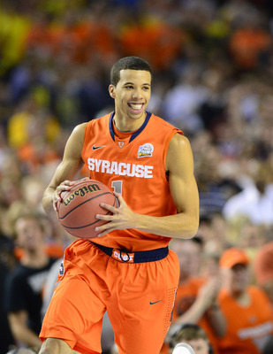 Apr 6, 2013; Atlanta, GA, USA; Syracuse Orange guard Michael Carter-Williams (1) reacts in the first half of the semifinals during the 2013 NCAA mens Final Four at the Georgia Dome.  Mandatory Credit: Bob Donnan-USA TODAY Sports