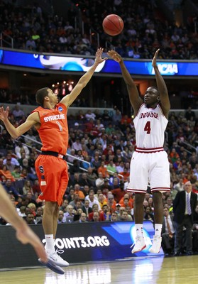 Mar 28, 2013; Washington, D.C., USA; Indiana Hoosiers guard Victor Oladipo (4) shoots as Syracuse Orange guard Michael Carter-Williams (1) defends in the second half during the semifinals of the East regional of the 2013 NCAA tournament at the Verizon Cen