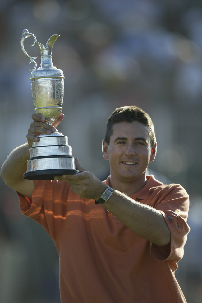 SANDWICH, ENGLAND - JULY 20:  Ben Curtis of the USA lifts the trophy aloft after victory in the Open Championship at the Royal St. George's course on July 20, 2003 in Sandwich, England.  (Photo by David Cannon/Getty Images)