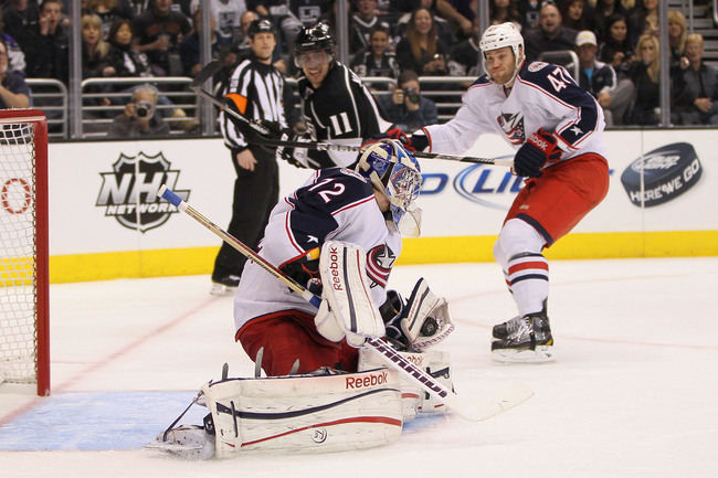LOS ANGELES, CA - APRIL 18:  Goaltender Sergei Bobrovsky #72 of the Columbus Blue Jackets makes a glove save on a shot by Dustin Brown (not pictured) of the Los Angeles Kings as Dalton Prout #47 of the Blue Jackets and Anze Kopitar #11 of the Kings vie fo