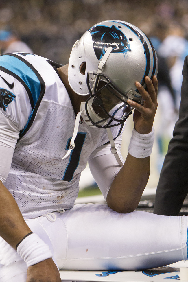 NEW ORLEANS, LA - DECEMBER 30:  Cam Newton #1 of the Carolina Panthers on the sidelines in pain while having his ankle wrapped during a game against the New Orleans Saints at Mercedes-Benz Superdome on December 30, 2012 in New Orleans, Louisiana.  The Pan