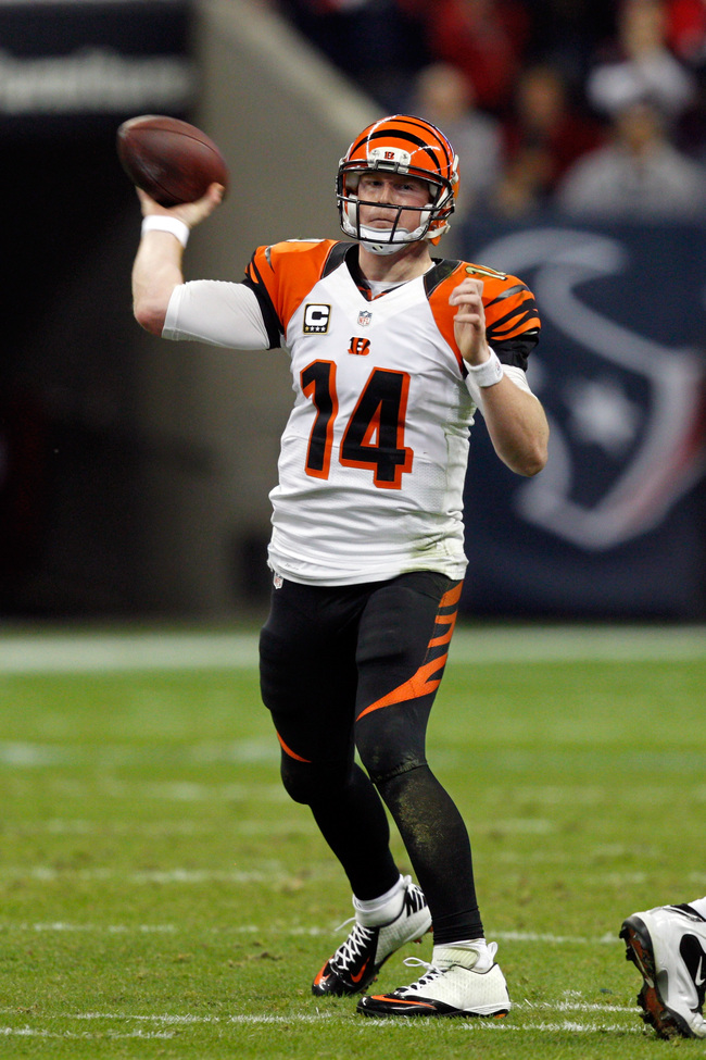 HOUSTON, TX - JANUARY 05:  Andy Dalton #14 of the Cincinnati Bengals throws a pass against the Houston Texans during their AFC Wild Card Playoff Game at Reliant Stadium on January 5, 2013 in Houston, Texas.  (Photo by Bob Levey/Getty Images)
