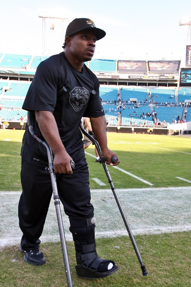 November 4, 2012; Jacksonville, FL, USA; Jacksonville Jaguars running back Maurice Jones-Drew (32) walks off the field with crutches after the game against the Detroit Lions at EverBank Field. The Lions defeated the Jaguars 31-14. Mandatory Credit: Rob Fo