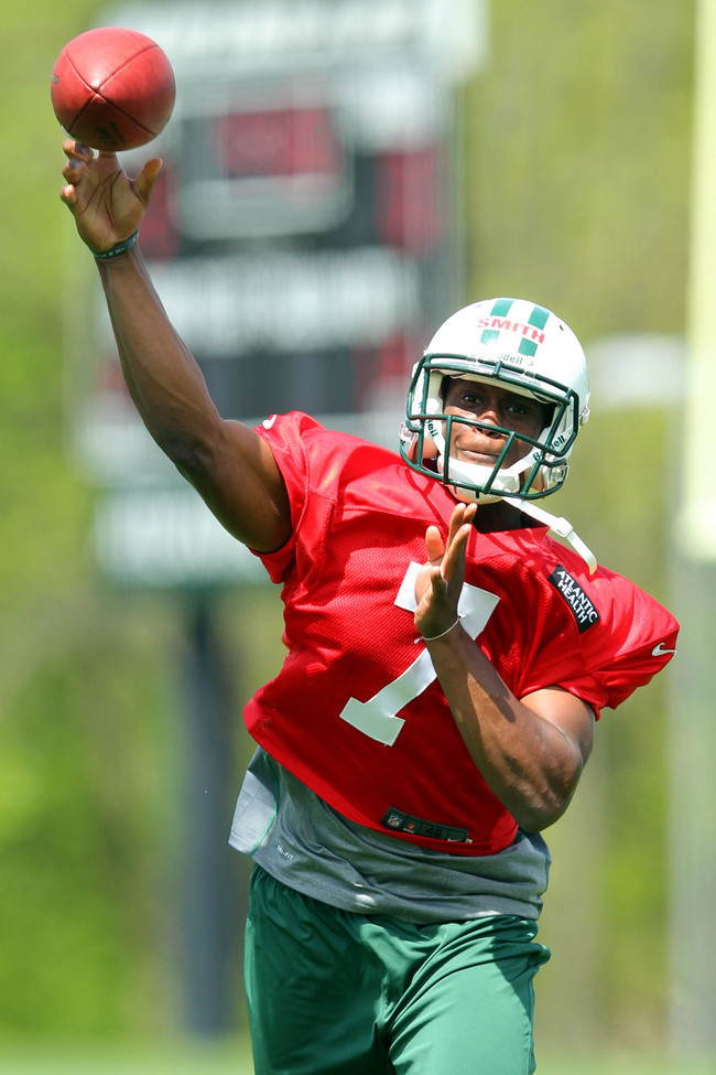 May 10, 2013; Florham Park, NJ, USA; New York Jets rookie quarterback Geno Smith (7) drops back to pass during New York Jets rookie minicamp at the Atlantic Health Jets Training Center. Mandatory Credit: Brad Penner-USA TODAY Sports