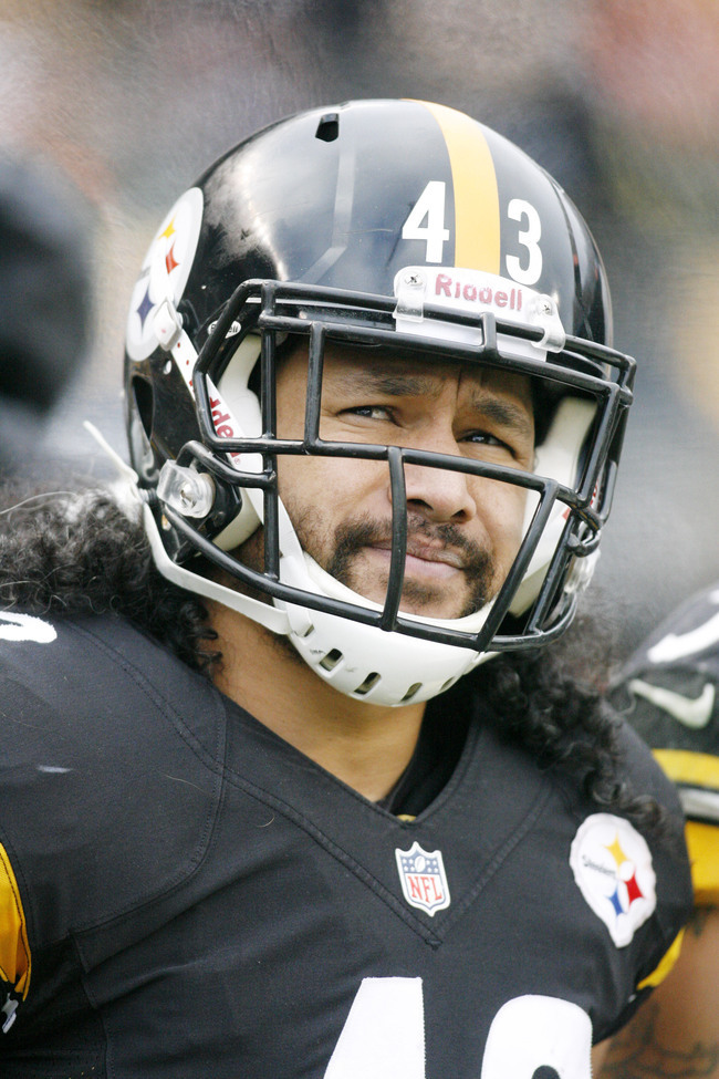 December 30, 2012; Pittsburgh, PA, USA; Pittsburgh Steelers strong safety Troy Polamalu (43) looks on from the sidelines against the Cleveland Browns during the fourth quarter at Heinz Field. The Pittsburgh Steelers won 24-10. Mandatory Credit: Charles Le