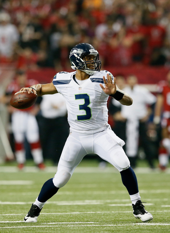 ATLANTA, GA - JANUARY 13:   Russell Wilson #3 of the Seattle Seahawks looks to pass against the Atlanta Falcons during the NFC Divisional Playoff Game at Georgia Dome on January 13, 2013 in Atlanta, Georgia.  (Photo by Kevin C. Cox/Getty Images)