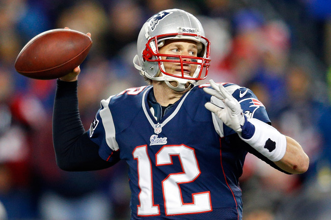 FOXBORO, MA - JANUARY 20:  Tom Brady #12 of the New England Patriots looks to throw against the Baltimore Ravens during the 2013 AFC Championship game at Gillette Stadium on January 20, 2013 in Foxboro, Massachusetts.  (Photo by Jim Rogash/Getty Images)