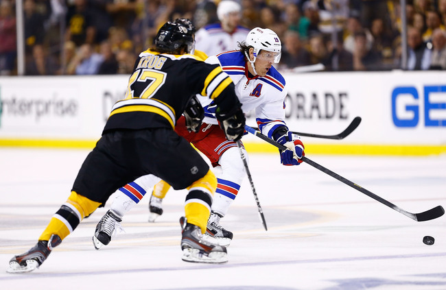 BOSTON, MA - MAY 16:  Brad Richards #19 of the New York Rangers skates with the puck in front of Torey Krug #47 of the Boston Bruins in overtime in Game One of the Eastern Conference Semifinals during the 2013 NHL Stanley Cup Playoffs on May 16, 2013 at T