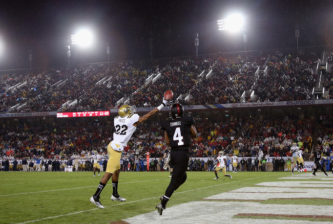 STANFORD, CA - NOVEMBER 30: Drew Terrell #4 of the Stanford Cardinal catches a touchdown pass that Sheldon Price #22 of the UCLA Bruins can not knock down during the Pac-12 Championship game at Stanford Stadium on November 30, 2012 in Stanford, California