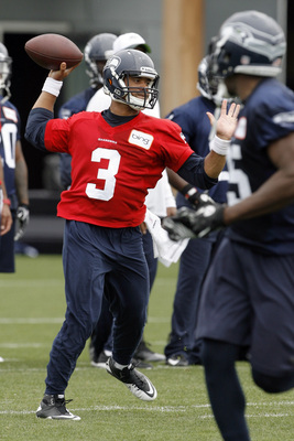 May 30, 2012; Renton, WA, USA; Seattle Seahawks quarterback Russell Wilson (3) participates in a passing drill of an OTA practice at the Virginia Mason Athletic Center. Mandatory Credit: Joe Nicholson-USA TODAY Sports