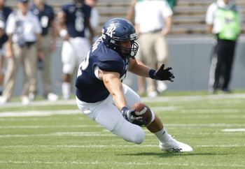 Sep 22, 2012; College Station, TX, USA; Rice Owls tight end Luke Willson (82) attempts to catch a pass against the Marshall Thundering Herd in the first quarter at Rice Stadium. Mandatory Credit: Brett Davis-USA TODAY Sports
