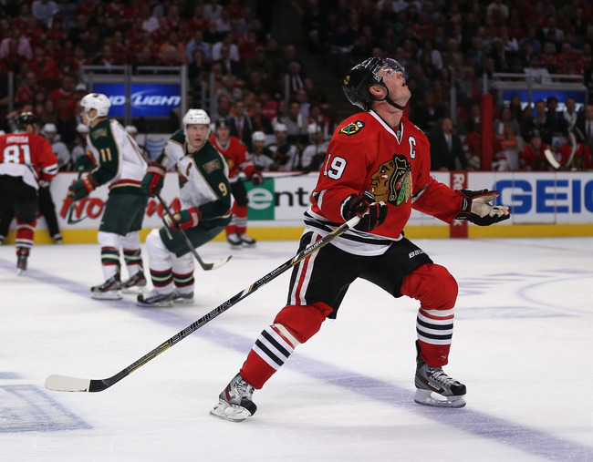 CHICAGO, IL - APRIL 30: Jonathan Toews #19 of the Chicago Blackhawks looks for the puck after was flipped into the air against the Minnesota Wild in Game One of the Western Conference Quarterfinals during the 2013 NHL Stanley Cup Playoffs at the United Ce