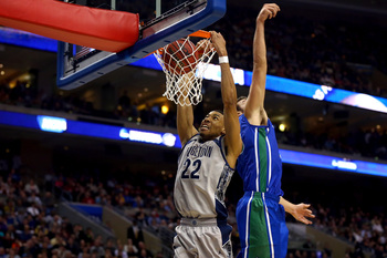 PHILADELPHIA, PA - MARCH 22:  Otto Porter Jr. #22 of the Georgetown Hoyas dunks in the second hal fagainst Chase Fieler #20 of the Florida Gulf Coast Eagles during the second round of the 2013 NCAA Men's Basketball Tournament at Wells Fargo Center on Marc