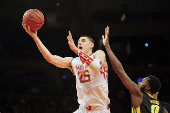 Apr 2, 2013; New York, NY, USA; Maryland Terrapins center Alex Len (25) goes up for a layup over Iowa Hawkeyes center Gabriel Olaseni (0) during the first half of the NIT Tournament semifinal at Madison Square Garden. Mandatory Credit: Joe Camporeale-USA