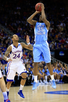 KANSAS CITY, MO - MARCH 24:  Reggie Bullock #35 of the North Carolina Tar Heels attempts a shot in the first half against Travis Releford #24 of the Kansas Jayhawks during the third round of the 2013 NCAA Men's Basketball Tournament at Sprint Center on Ma