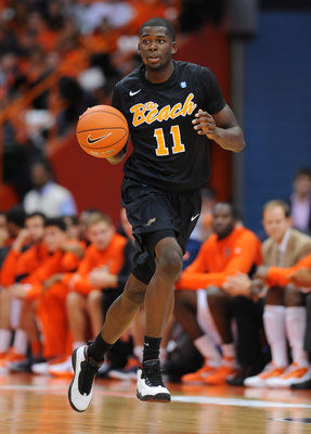 Dec 6, 2012; Syracuse, NY, USA; Long Beach State 49ers guard/forward James Ennis (11) dribbles the ball up court during the second half against the Syracuse Orange at the Carrier Dome.  Syracuse defeated Long Beach State 84-53.  Mandatory Credit: Rich Bar
