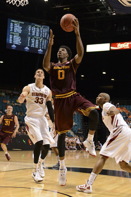 March 13, 2013; Las Vegas, NV, USA; Arizona State Sun Devils guard/forward Carrick Felix (0) shoots against Stanford Cardinal forward Dwight Powell (33) during the second half in the first round of the Pac 12 tournament at the MGM Grand Garden Arena. Ariz