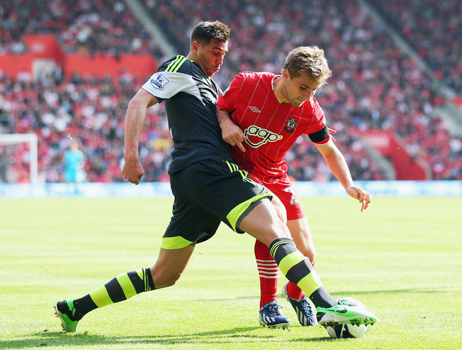 SOUTHAMPTON, ENGLAND - MAY 19:  Geoff Cameron of Stoke City tackles Luke Shaw of Southampton during the Barclays Premier League match between Southampton and Stoke City at St Mary's Stadium on May 19, 2013 in Southampton, England.  (Photo by Bryn Lennon/G