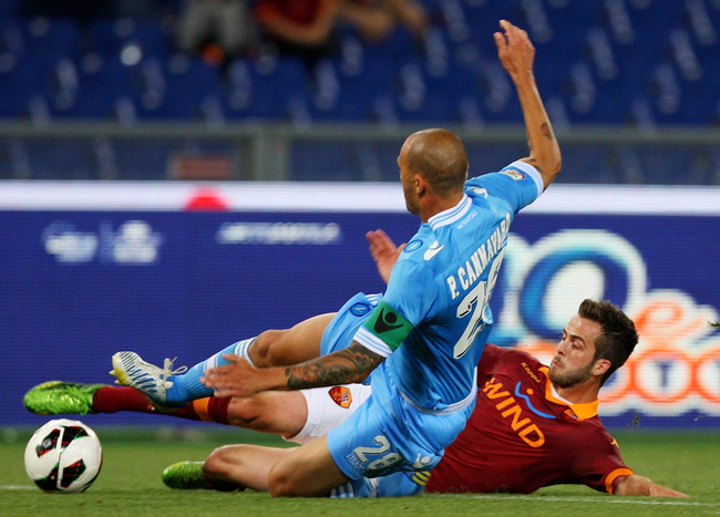 ROME, ITALY - MAY 19: Miralem Pjanic (R) of AS Roma competes for the ball with Paolo Cannavaro of SSC Napoli players during the Serie A match between AS Roma and SSC Napoli at Stadio Olimpico on May 19, 2013 in Rome, Italy.  (Photo by Paolo Bruno/Getty Im