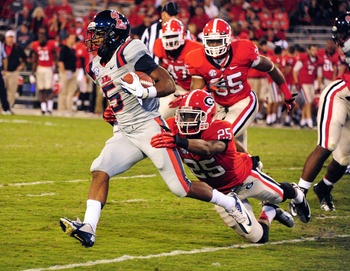 ATHENS, GA - NOVEMBER 3: I'Tavius Mathers #5 of the Ole Miss Rebels is tackled by Josh Harvey-Clemons #25 of the Georgia Bulldogs at Sanford Stadium on November 3, 2012 in Athens, Georgia. (Photo by Scott Cunningham/Getty Images)
