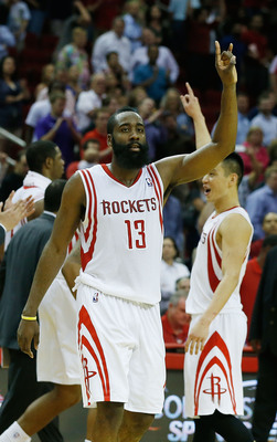 HOUSTON, TX - APRIL 09:  James Harden #13 of the Houston Rockets celebrates a shot at the buzzer with Jeremy Lin #7 to defeat the Phoenix Suns 101-98 at the Toyota Center on April 9, 2013 in Houston, Texas. NOTE TO USER: User expressly acknowledges and ag