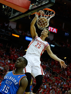 HOUSTON, TX - MAY 03:  Chandler Parsons #25 of the Houston Rockets dunks over Reggie Jackson #15 of the Oklahoma City Thunder in Game Six of the Western Conference Quarterfinals of the 2013 NBA Playoffs at the Toyota Center on May 3, 2013 in Houston, Texa