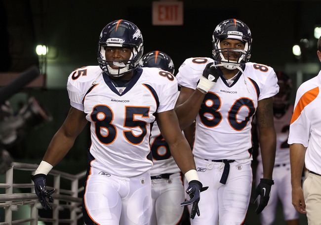 GLENDALE, AZ - SEPTEMBER 01:  Tight ends Virgil Green #85 and Julius Thomas #80 of the Denver Broncos walk out onto the field before the preseason NFL game against the Arizona Cardinals at the University of Phoenix Stadium on September 1, 2011 in Glendale