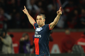 PARIS, FRANCE - MAY 18:  Zlatan Ibrahimovic of PSG celebrates after scoring to make it 3-0 during the Ligue 1 match between Paris Saint-Germain FC and Stade Brestois 29 at Parc des Princes on May 18, 2013 in Paris, France.  (Photo by Michael Regan/Getty I