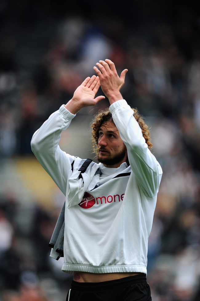 NEWCASTLE UPON TYNE, ENGLAND - MAY 19:  Newcastle captain Fabricio Coloccini applauds the crowd after the Barclays Premier League match between Newcastle United and Arsenal at St James' Park on May 19, 2013 in Newcastle upon Tyne, England.  (Photo by Stu