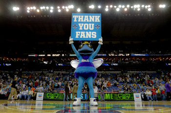 Apr 14, 2013; New Orleans, LA, USA; New Orleans Hornets mascot Hugo holds up a sign thanking fans for support following a loss to the Dallas Mavericks at the New Orleans Arena. The Mavericks defeated the Hornets 107-89. The game was the final home game fo