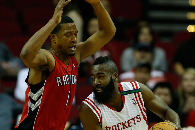 HOUSTON, TX - NOVEMBER 27:  Dominic McGuire #1 of the Toronto Raptors defends against James Harden #13 the Houston Rockets at the Toyota Center on November 27, 2012 in Houston, Texas. NOTE TO USER: User expressly acknowledges and agrees that, by downloadi
