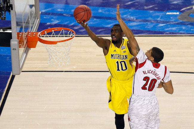 ATLANTA, GA - APRIL 08:  Tim Hardaway Jr. #10 of the Michigan Wolverines drives for a shot attempt in the first half against Wayne Blackshear #20 of the Louisville Cardinals during the 2013 NCAA Men's Final Four Championship at the Georgia Dome on April 8
