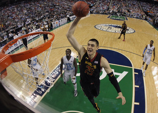 GREENSBORO, NC - MARCH 16:  Alex Len #25 of the Maryland Terrapins goes up for a dunk against the North Carolina Tar Heels during the semifinals of the Men's ACC Basketball Tournament at Greensboro Coliseum on March 16, 2013 in Greensboro, North Carolina.