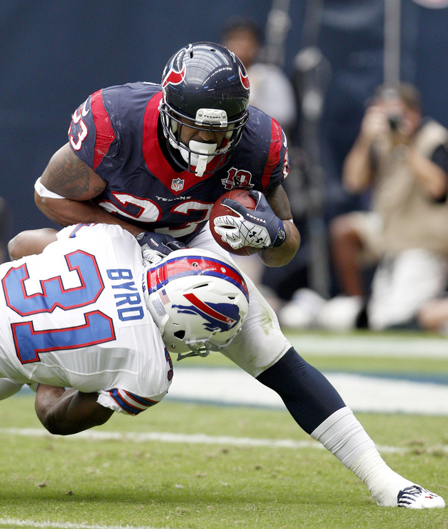 HOUSTON, TX- NOVEMBER 04: Houston Texans running back Arian Foster #23 is tackled by Buffalo Bills safety Jairus Byrd #31on November 4, 2012 at Reliant Stadium in Houston, Texas. (Photo by Thomas B. Shea/Getty Images)