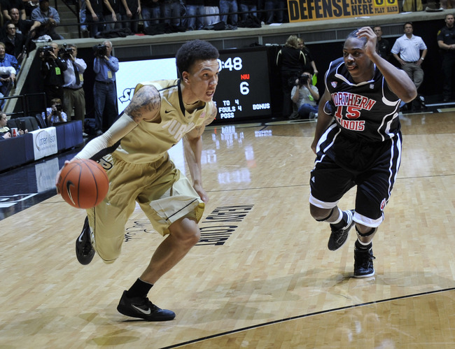 Nov 11, 2011; West Lafayette, IN, USA; Purdue Boilermakers guard Anthony Johnson (1) drives against Northern Illinois Huskies guard Marquavese Ford (15) during the first half at Mackey Arena. Mandatory Credit: Sandra Dukes-USA TODAY Sports.