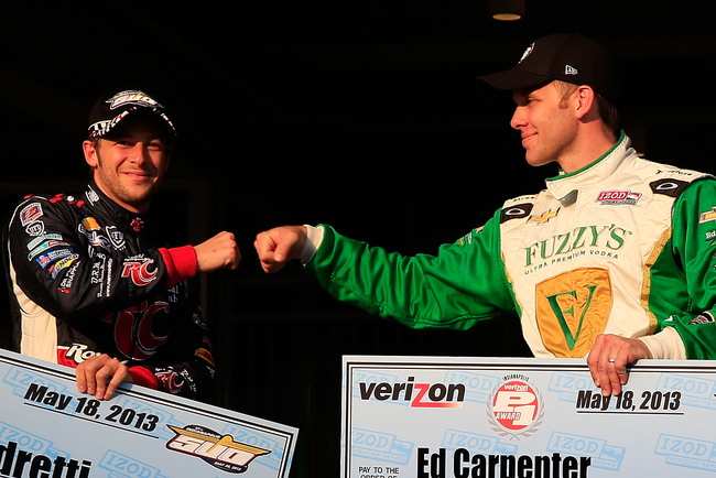 INDIANAPOLIS, IN - MAY 18:  Pole-winner Ed Carpernter, driver of the #20 Fuzzy's Vodka/Ed Carpenter Racing Chevrolet is congratulated by third place Marco Andretti, driver of the #25 Andretti Autosport RC Cola Chevrolet, after qualifying  for the 2013 Ind