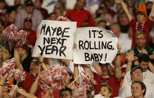Jan 7, 2013; Miami, FL, USA; Alabama Crimson Tide fans hold up signs during the game against the Notre Dame Fighting Irish during the 2013 BCS Championship game at Sun Life Stadium. Alabama won 42-14.  Mandatory Credit: Matthew Emmons-USA TODAY Sports
