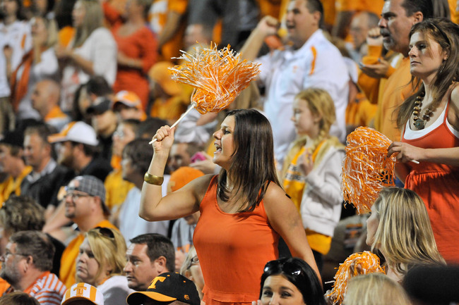 Sep 22, 2012; Knoxville, TN, USA; Tennessee Volunteers fan Julie Etter cheers for her team against the Akron Zips during the second half at Neyland Stadium. Tennessee defeated Akron, 47-26. Mandatory Credit: Jim Brown-USA TODAY Sports